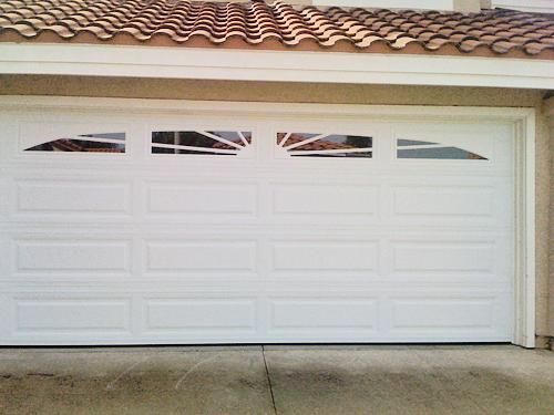 Unique raised panel Sunburst windows garage door