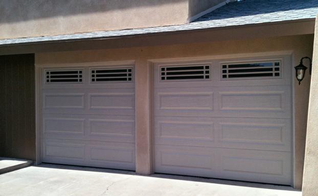 Long raised sandstone panel garage doors