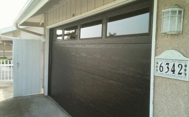 Unique garage door brown flush design